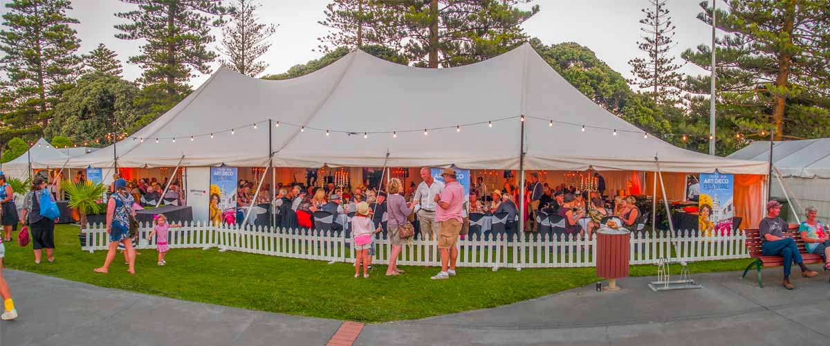 Art Deco Festival marquee open on one side to enjoy buffet dinner, music and the sea views