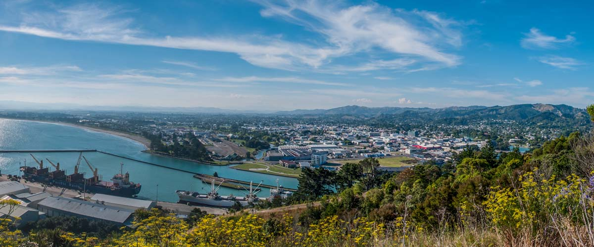 From the lookout in Gisborne, port view and long sandy beach, a day trip from Hawkes Bay