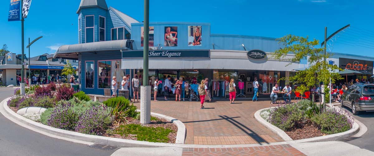 Havelock North Village centre with al fresco restaurant, outdoor sitting area, pedestrian shopping street with fashion shops, souvenirs, gifts