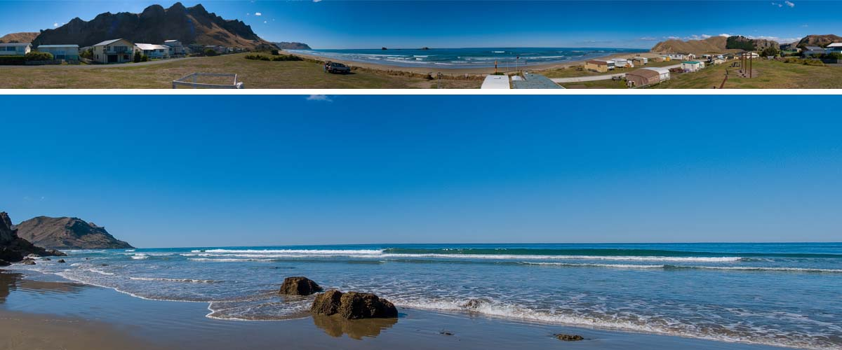 Kairakau beach with luxury holiday houses at the waterfront. The wavy sea is coming in along the rocky coastline
