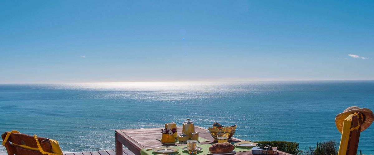 Blue sky, ocean as far as you can see, lunch table just for two. The real ocanfront luxury escape