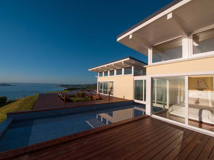 Luxury holiday home overlooking the sea at sunrise in the North Island, New Zealand