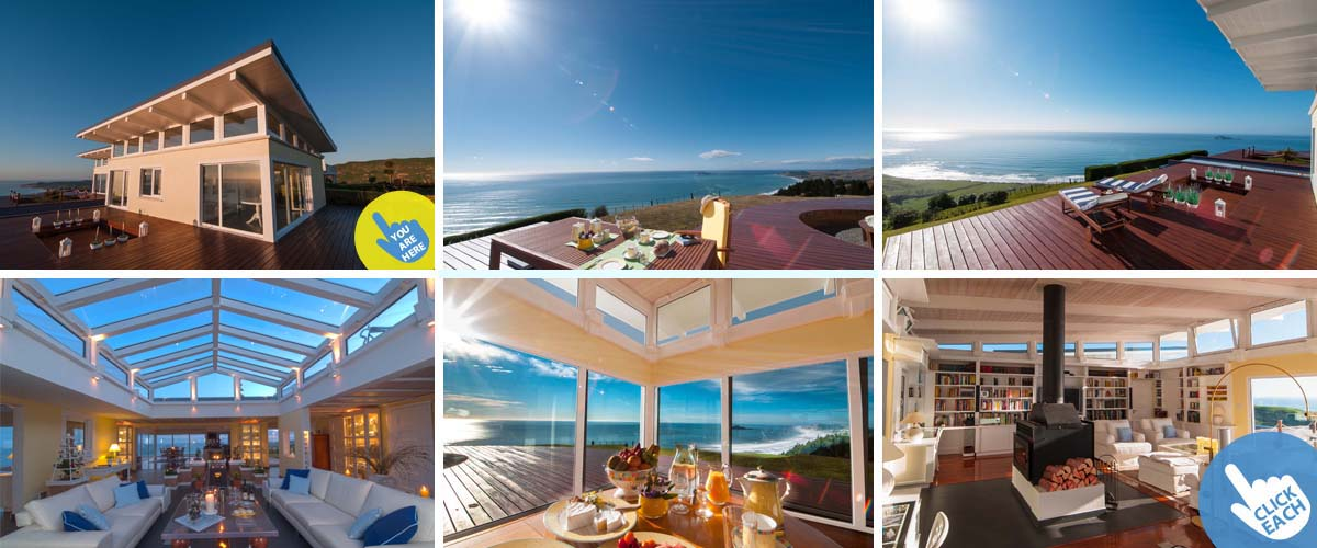 Luxury boutique lodge Napier, with ocean view deck, atrium, lounge with open fireplace and oceanfront breakfast table
