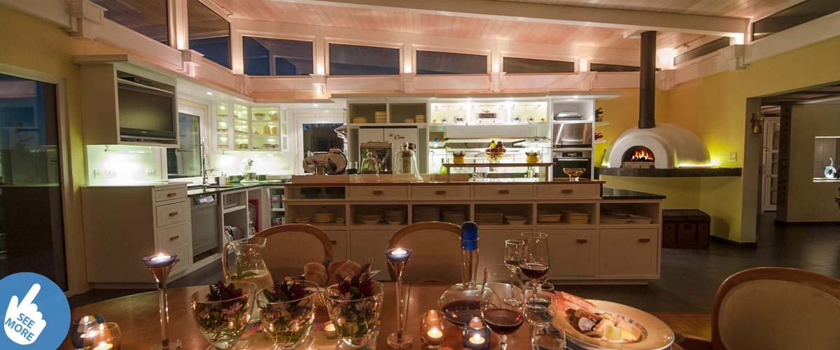 Bay Guesthouse Chef's table for two. Pizza oven fireplace going, romantic atmosphere with candle lights, wine and dish