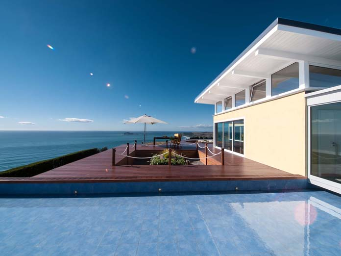 Unique seaside accommodation with expansive outside deck area overlooking the uninterrupted ocean views in one of the best spots in New Zealand.