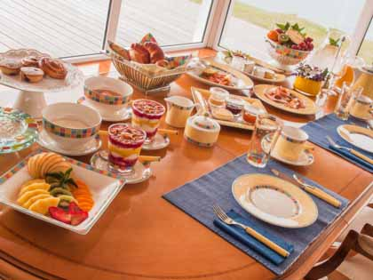 Cheese, homemade bread, sweets, fruits, muesli, parma ham, cheese, fresh orange jus and lots more on your private breakfast table. Panorama sea view included.