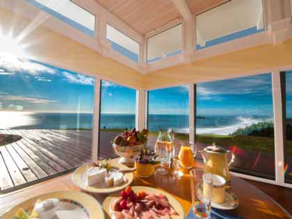 Decadent breakfast table with boundless sea views in the North Island, New Zealand