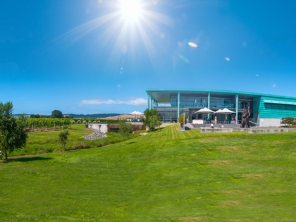 Sunny coastal vineyard with onsite restaurant and wine tastings overlooking the vines in Hawkes Bay