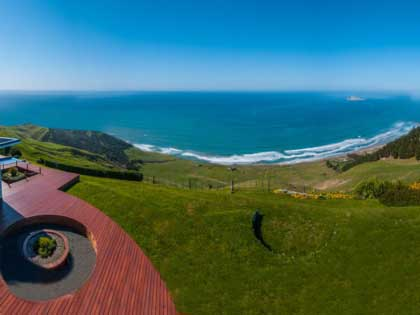 Spacious wooden deck to wander and gaze over the endless ocean views at Bay Guesthouse, North Island, New Zealand.